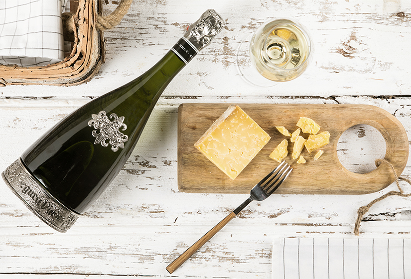 fork with cheese and cava